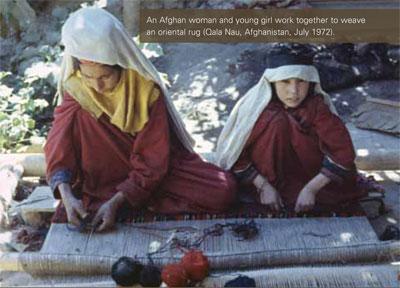 An Afghan woman and young girl work together to weave an oriental rug (Qala Nau, Afghanistan, July 1972).