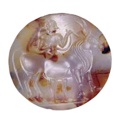 An agate lentoid seal, dated ca. 1500–1300 BC, is from Minoan Crete. It depicts a man leading a bull. BM Image #1892,0720.2.