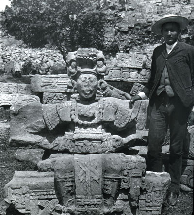 Honduran government representative Don Carlos Madrid stands next to a figure from the Hieroglyphic Stairway, ca. 1900.