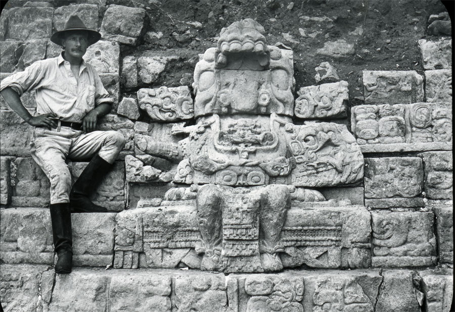 Gordon sits next to a figure seated on a throne on the Hieroglyphic Stairway, ca. 1900