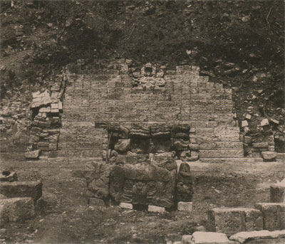 George B. Gordon excavated the Hieroglyphic Stairway on the Peabody Museum expedition to Copan, Honduras. Here are the lower steps of the Hieroglyphic Stairway the altar and the first seated figure as found, ca. 1900. Today the stairway rises 69 feet of about 21 meters.Penn Museum Image: 228288