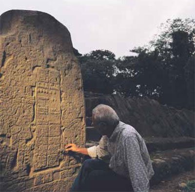 Tak'alik Ab'aj is a large Late Preclassic site in southwest Guatemala. Stela  5 from that site, shown here with archaeologist Miguel Orrego, depicts  two rulers separated by a text that includes two early Long Count dates,  the latest equivalent to 126 CE.