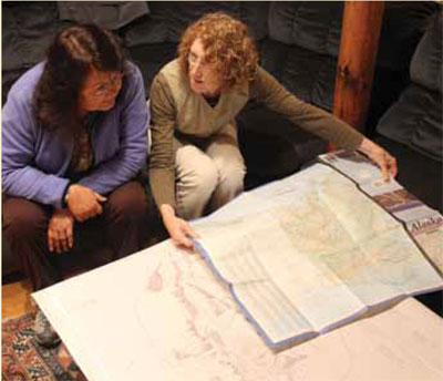 Marsha  Hotch (left) and  Alice Taff examine  a replica copy of  the Kohklux map at  the home of Kathy  and Bill Ruddy, near  Juneau, Alaska.