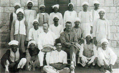 Clarence Fisher (left, seated) and gerald Fitzgerald pose for a photograph with local workers 1921. Penn Museum Image: 238270