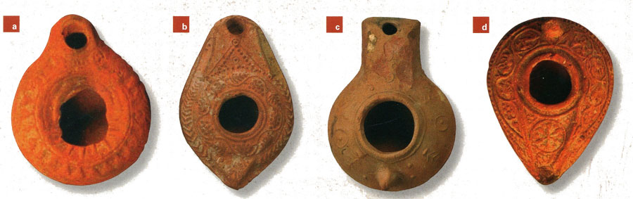 Above from left to right: (a) A simple, molded clay lamp of the early Byzantine period, probably 4th century in date. Museum Object Number: 29-102-3. (b) Amolded clay lamp of the so-called Beit Natif type, from the 5th or 6th century. Museum Object Number: 31-50-30. (c) Another molded clay lamp is a variation of the Beit Natif type, with sparse, raised decoration. Museum object #31-50-15. (d) A molded clay lamp decorated with a vine scroll and a Christogram, dating from the end of the Byzantine period, aroundthemiddle of the 7th century. Museum Object Number: 29-102-285.