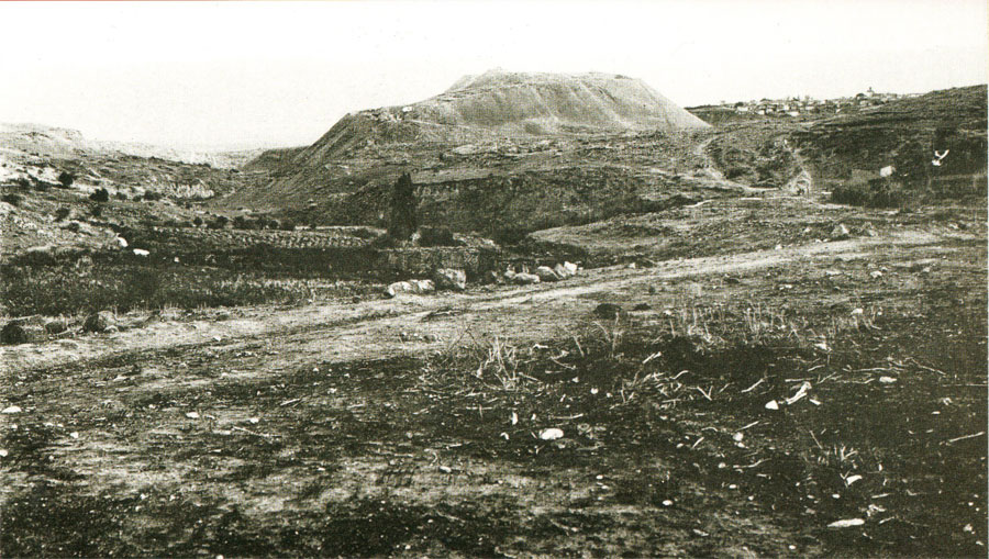 A photograph taken in the 1920s looks eastward, with the area of the Northern Cemetery to the left and the tell rising in the distance.