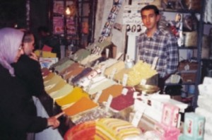 Mary M. Voigt, one of the three Americans on the trip, admires an artful display in the Kermanshah spice bazaar. I purchased some saffron and zereshk (barberries; middle, front) for pilaf. Below is the basic recipe for Iranian rice, chelo , a special treat.