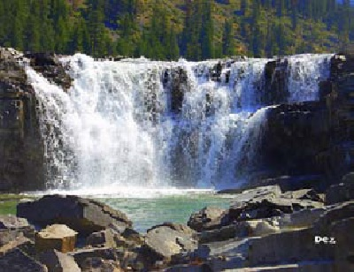 Kootenai Falls, near Libby, Montana. Kootenai Falls is the largest free-flowing waterfall in Montana and one of the largest in the Northwest. It is sacred to the Kootenai Tribe of the Confederated Salish and Kootenai Tribes of the Flathead Reservation in Montana, the Kootenai Tribe of Idaho, and the Kootenay First Nation in British Columbia, Canada. In the early 1970s, the three Nations combined forces and defeated proposed hydroelectric development at the Falls, with cultural data which is in protected status in perpetuity through an adjudicated decision in the Federal Energy Regulatory Commission. Photo courtesy Flickr, Photo Sharing.