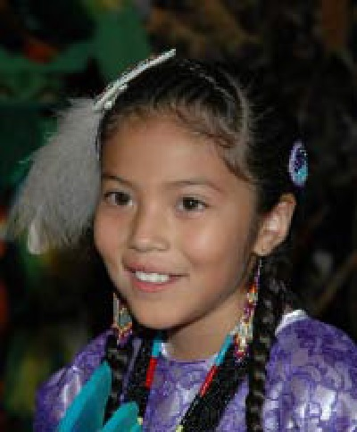 Families and children from many Native groups took part in NARF's 40th Anniversary powwow.  Picture shown is of a young girl who participates in a dance.