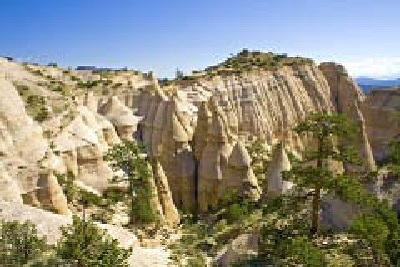 Kasha-Katuwe, Tent Rocks National Monument, Pueblo de Cochiti, New Mexico. The Pueblo de Cochiti and the U.S. Bureau of Land Management protect Kasha-Katuwe through tribal and federal law and a co-management agreement that provides for the public to visit this sacred place during most days, except when the Pueblo closes it for ceremonies. Kasha-Katuwe (White Cliffs) is located mid-way between Albuquerque and Santa Fe. Photo courtesy Julius Rickert, 2008.