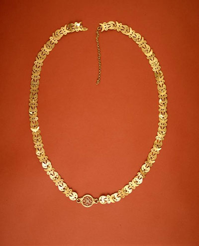 The gold necklace recovered from the floor level of Room H is a fine example of Byzantine pierced work. Museum Object Number: 31-50-212.