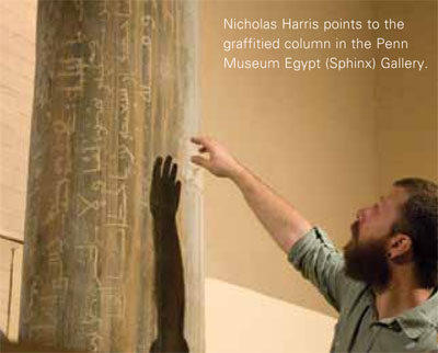 Nicholas Harris points to the  graffitied column in the Penn Museum Egypt (Sphinx) Gallery.