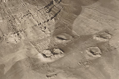 Looking southwest, this aerial photograph of the Senwosret III tomb enclosure at the base of the Mountain-of-Anubis was taken shortly after the early phase of work (1899–1903). Courtesy of the Egypt Exploration Society
