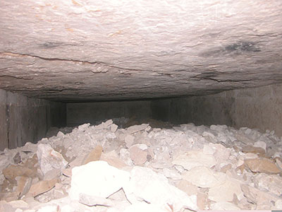 The first limestone chamber, nearly full to the ceiling with debris as we found it in 2006.
