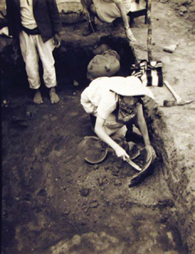 Dr. Mary Butler, shown unearthing ceramics in a communal burial plot, conducted excavations in the town of Nebaj, Quiché Dept., Guatemala, in 1941. UPM image #238643.