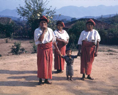 Maya women wear traje (traditional clothing) in Chajul, Quiché Dept., Guatemala, 1941. Photograph by Mary Butler. UPM image #179947