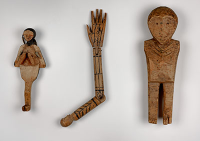 Shamanic ritual objects include a man-bird, an articulated arm with human head, and a man. UPM object #2003-43-283, 2003-43- 285, 2003-43-286.