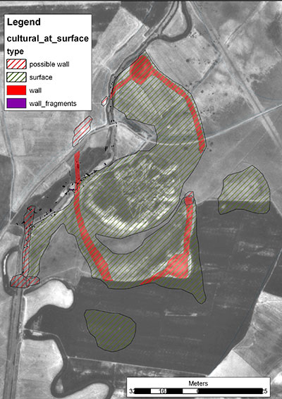 This annotated satellite image shows the ancient cultural material outcropping at the modern surface (green striped), and the Lower Town fortification circuit (red). Gordion Archaeological Project, Ben Marsh.