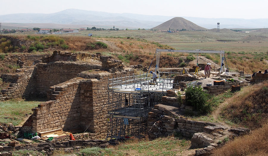 Conservation of the Early Phrygian Gate, looking west. In the background are the dig house compound (UPPER LEFT) and Tumulus MM (RIGHT). Photograph by Gebhard Bieg.