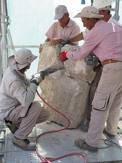 Members of the 2015 team work together to conserve masonry at the Citadel Gate. Photograph by Elisa Del Bono.