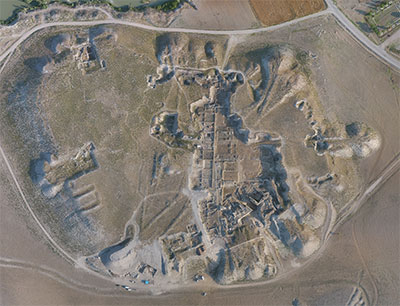 Gordion as shown in a drone photograph, taken by Lucas Stephens in 2014. Spoil heaps from early excavations can be seen around the perimeter. Image #CM4ortho-2014.