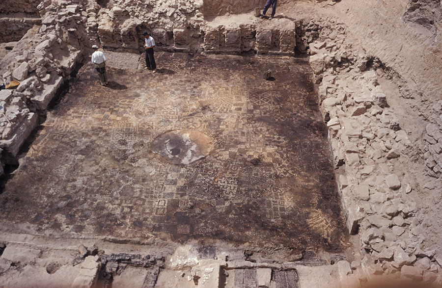 The Early Phrygian (ca. 850–800 BCE) pebble mosaic floor was excavated and cleaned in 1956. The section that is traveling from Gordion to Philadelphia is bordered by dotted white lines. Image #G-1973.