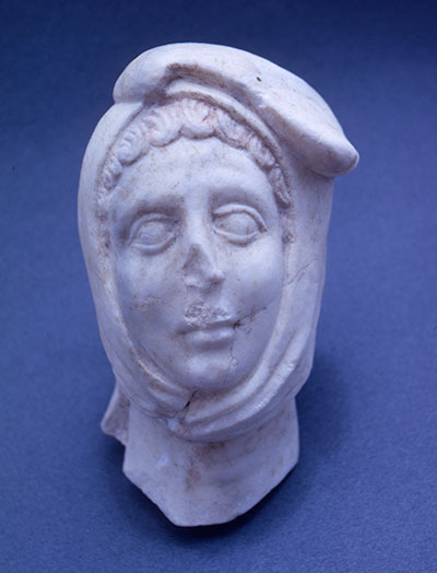 A marble head from Gordion (Inv. #7131-S-74) depicts a Persian wearing a Phrygian cap.