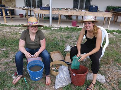mma McNamara and Janine van Noorden wash animal bones, including those of a camel.