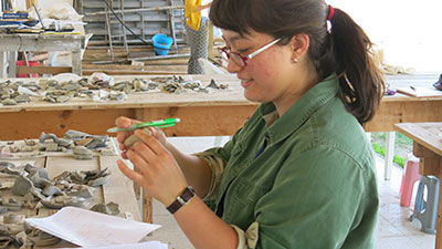 Caitlin Clerkin sorts Hellenistic pottery.