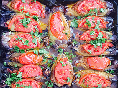 One of the more colorful dishes served for dinner is stuffed eggplant with tomatoes.