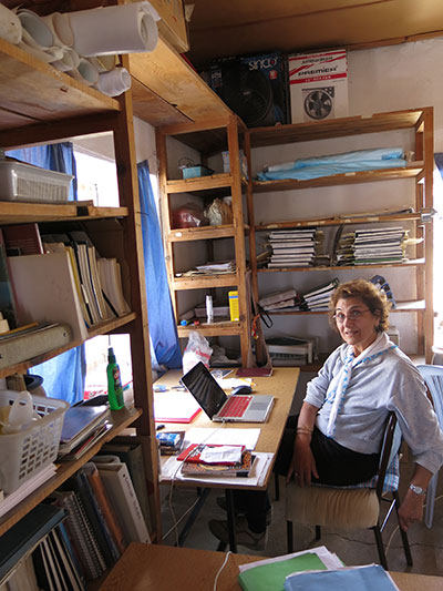 The author works at her desk in the dig house.