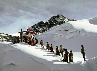 Photo of villagers in the mountain with a cross