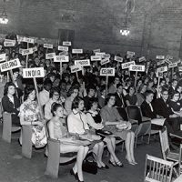 archival photo of people in Harrison auditorium