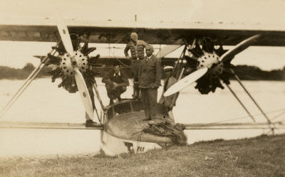 Rondon with flight crew and their plane