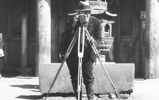 Portrait of C. W. Bishop with a camera