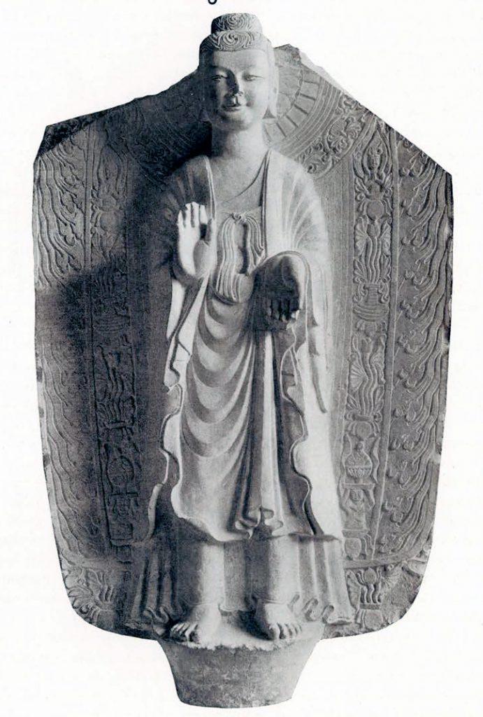 Grey limestone stela with high relief Sakyamuni Buddha against a mandorla
