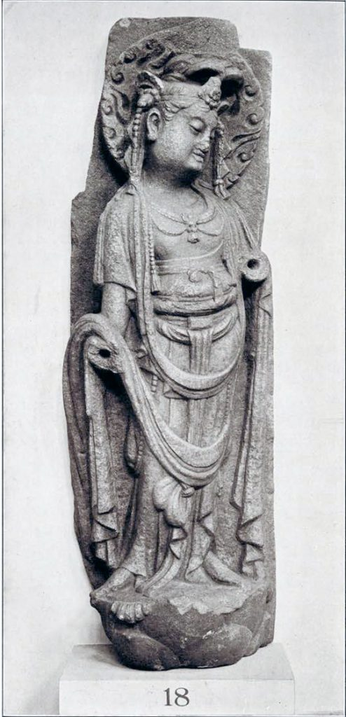 Stone bas relief of a bodhisattva on a lotus pedestal with arms broken off at the elbow