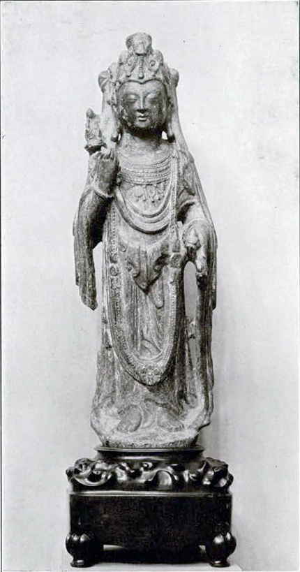 Stone bodhisattva holding a flower with a small deity, luxurious clothing