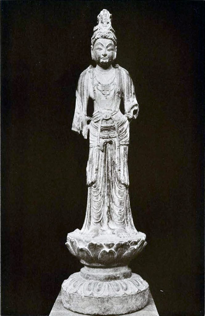 Grey limestone Bodhisattva with a headdress depicting the begging bowl of the Buddha, lower arms are missing