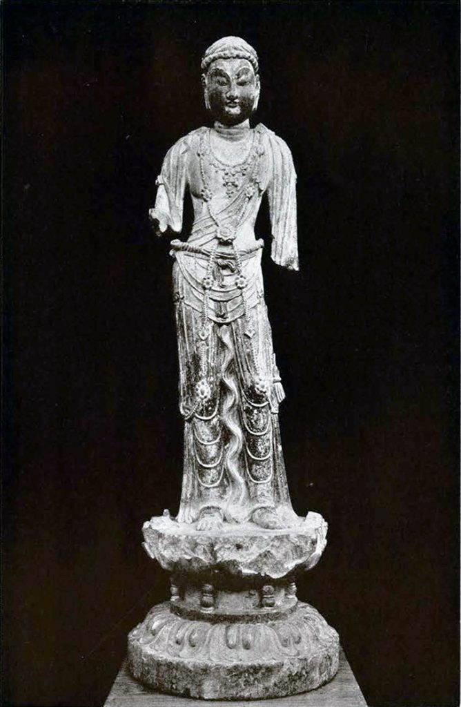 Stone statue of a Bodhisattva with clothing garb, arms missing from the elbows down