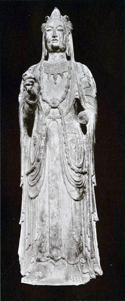 Limestone statue of a Bodhisattva wearing a tiara with a figure of the Amida Buddha, elaborate draping garb