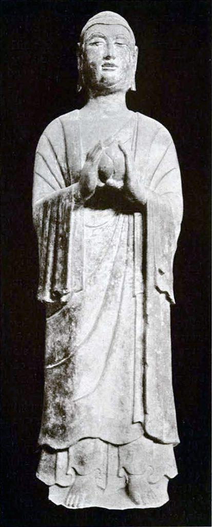 Stone statue of Pratyekabuddha, holding a lotus bud
