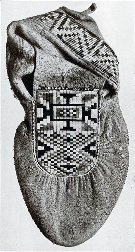 Moccasin decorated with woven quills