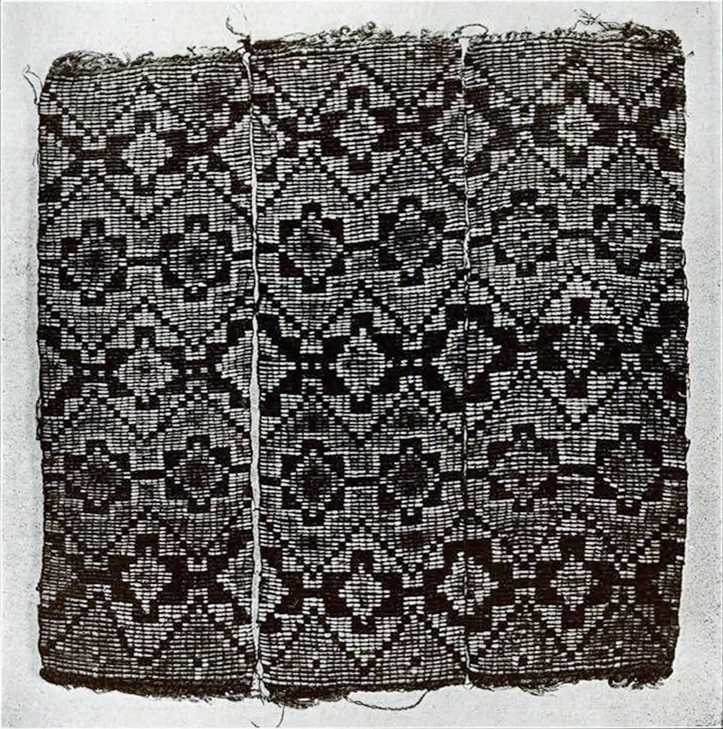 Three pieces of woven quill work in a geometric pattern
