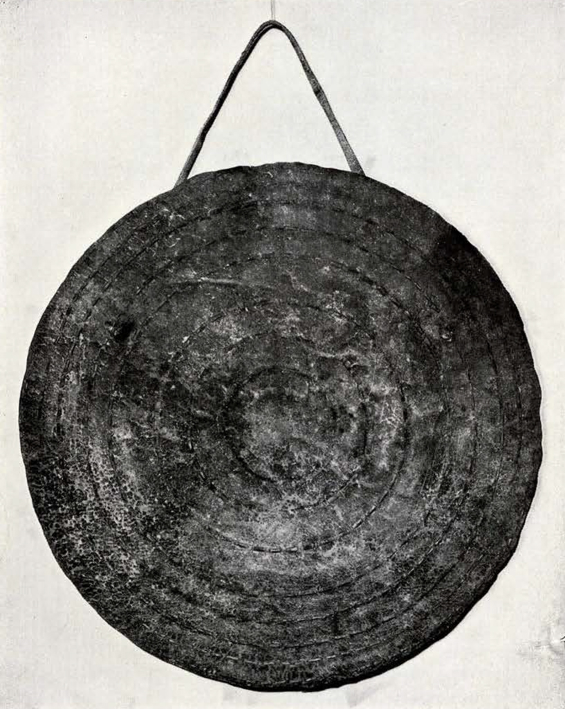round shield with stitching in concentric circles