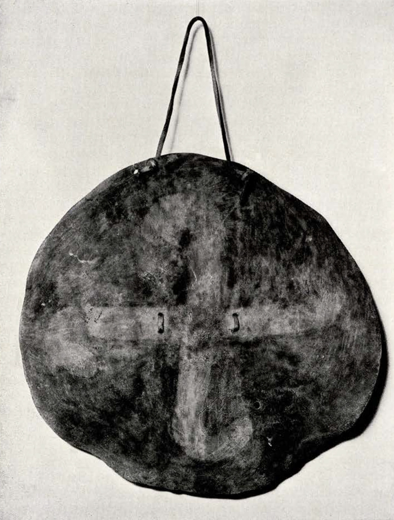 round shield with a cross in the middle