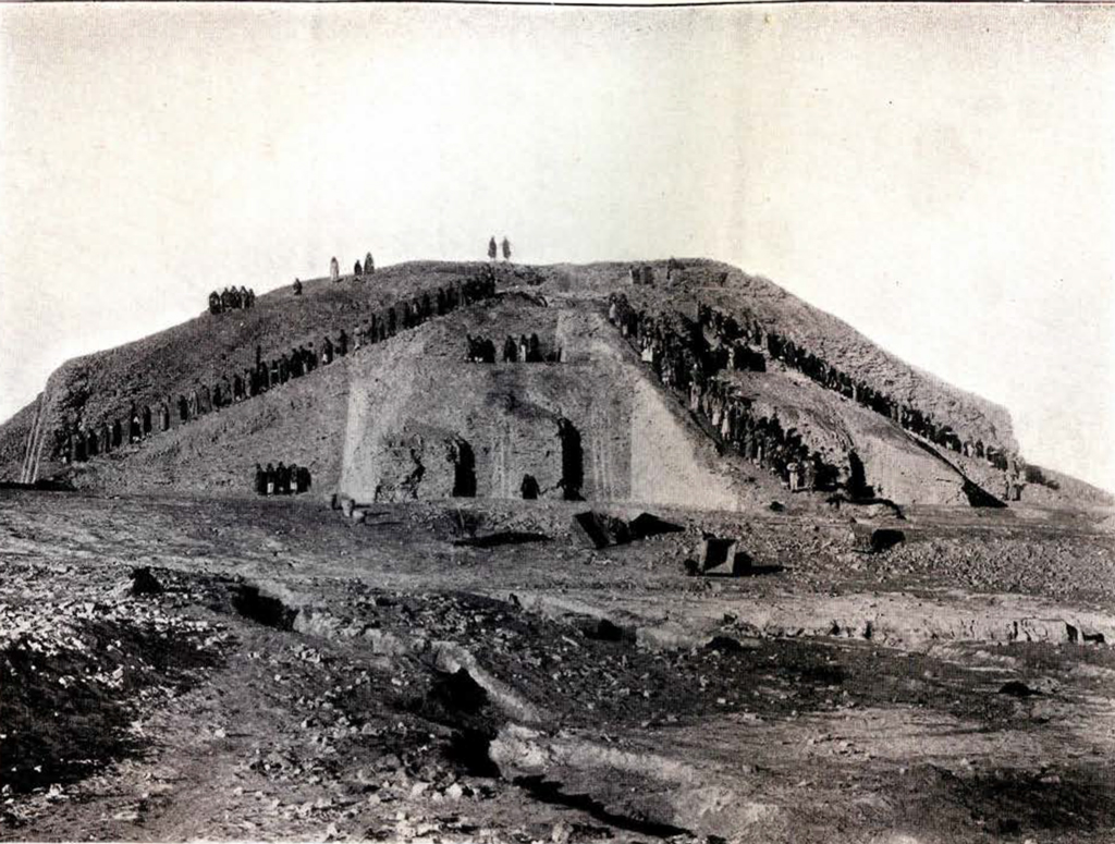 The Ziggurat in the middle of excavation, with three staircases full of people leading up to the top